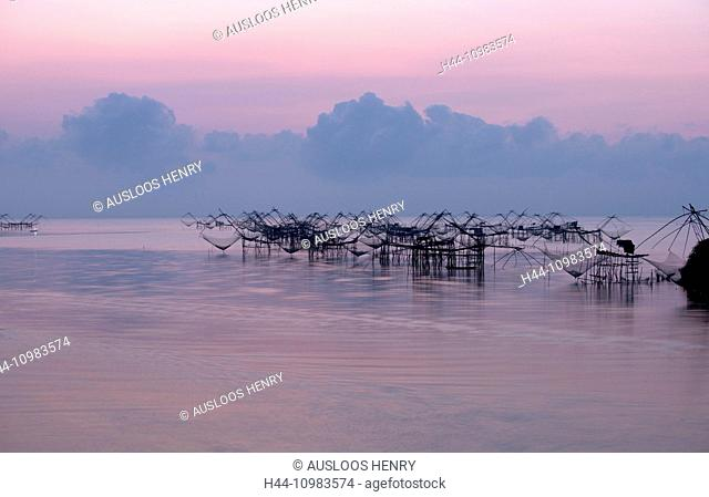 operated lift nets in Thailand at sunset