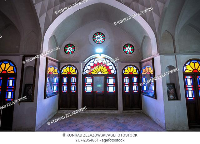 stained glass windows in historical Tabatabaei family house from 19th century in Kashan city, capital of Kashan County, Iran