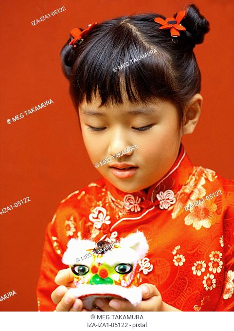 Close-up of a girl holding a toy