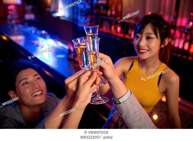 Young people drink at the bar