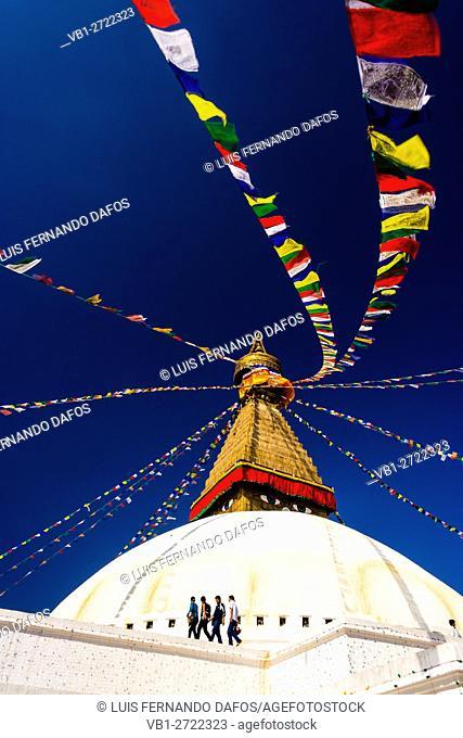 Boudhanath stupa and visitors. Kathmandu Valley, Nepal