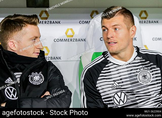 Wolfsburg, Germany, March 20, 2019: Toni Kroos and Marco Reus sitting on the bench during the international soccer game Germany vs Serbia at Volkswagen Arena