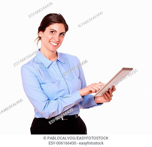 Portrait of a gorgeous hispanic young woman smiling, while working on a tablet pc, against isolated white background