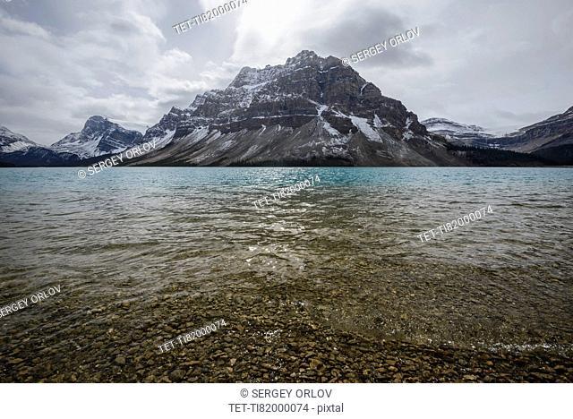 Canada, Alberta, Banff, Mountains reflecting in Bow Lake