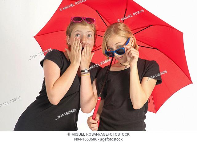 Two young German girls under an umbrella