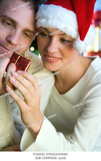 couple giving themself christmas presents