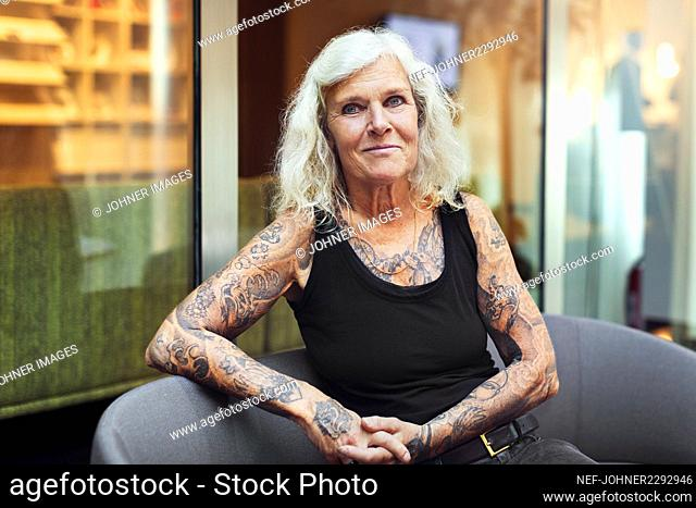 Portrait of senior woman with tattoos