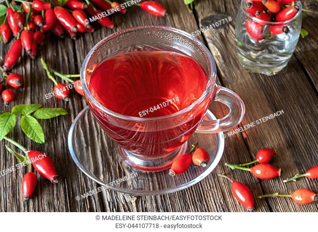 A cup of rose hip tea with fresh berries