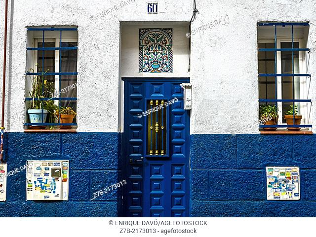 View of a blue front house in a street of Madrid city, Spain