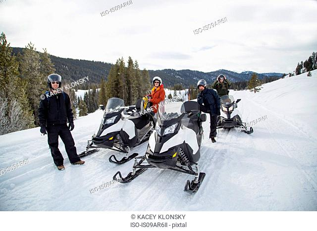 Friends on snowmobile, Jackson Hole, Wyoming