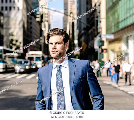 Handsome businessman walking in Manhattan