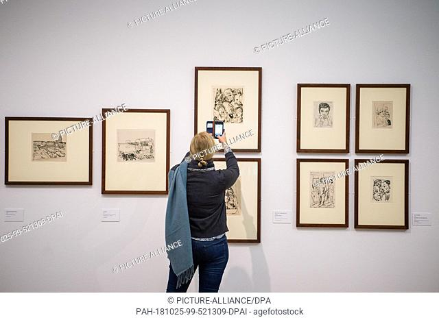25 October 2018, Berlin: A woman photographs drawings by the artist Max Beckmann (1884-1950), which he made during his time in Frankfurt in the 1920s