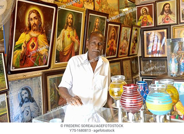 Man selling illustration and painting of Jesus Christ in Cochin,Kerala,South India,Asia