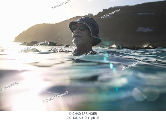 Senior man swimming in the sea