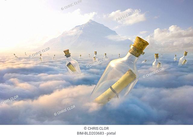 Messages in bottles floating in clouds