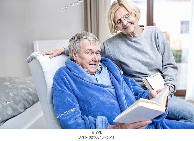 Senior couple reading book