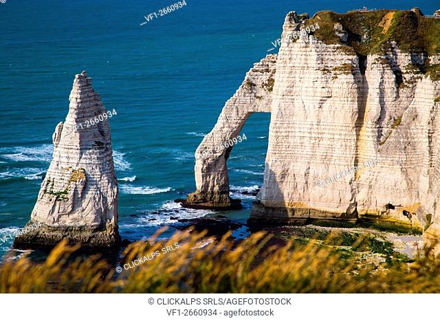 Etretat, Normandy, France. The cliffs over the Atlantic Ocean during a sunny day