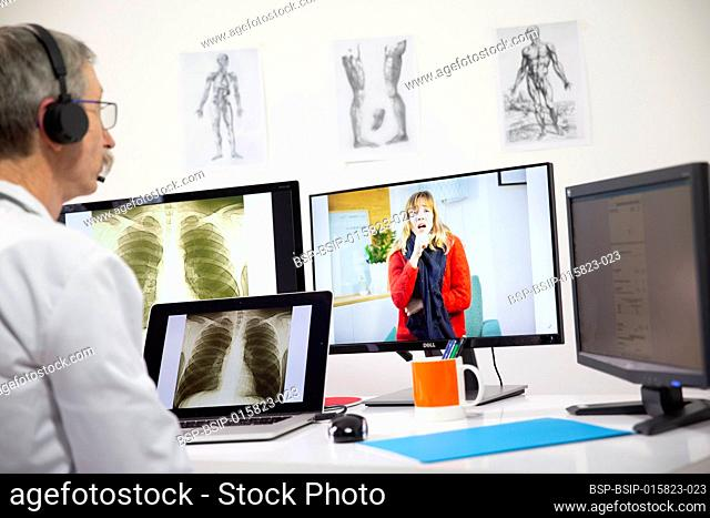 A GP during a video consultation looking at the x-ray of a woman's lungs who has a lung infection