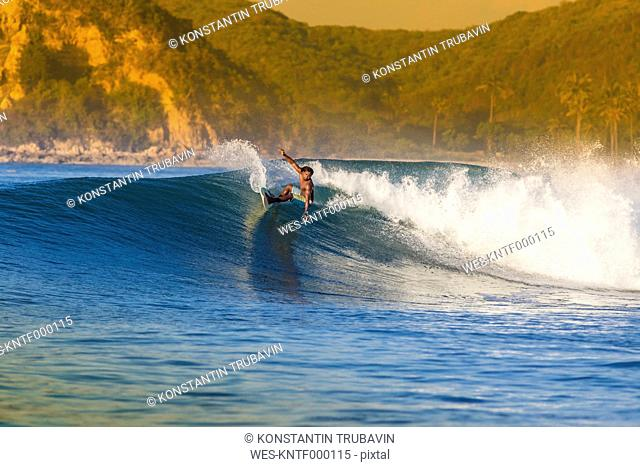 Indonesia, Lombok, surfing man