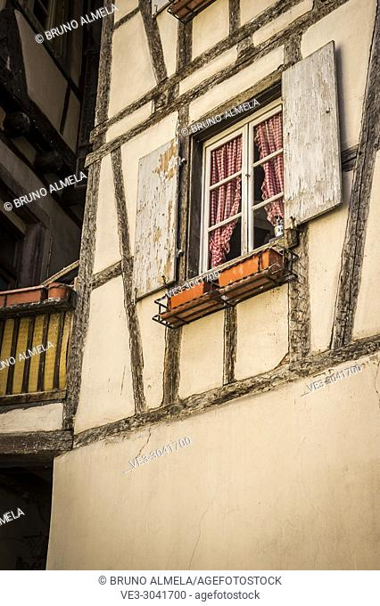 Medieval window in Colmar, Alsace (department of Haut-Rhin, region of Grand Est, France)