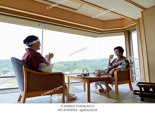 Japanese senior couple wearing yukata at a traditional hotel
