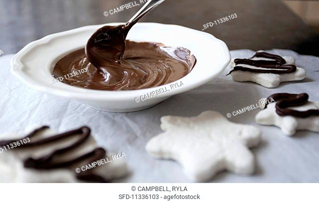 Liquid chocolate glaze in a white bowl