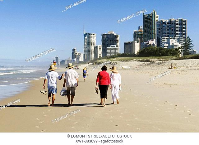 walking people on the beach at Surfers Paradise, Gold Coast, Queensland, Australia