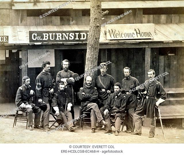 Civil War. Ambrose Everett Burnside with eight officers of the lst Rhode Island Volunteers in front of building, with sign reading Col