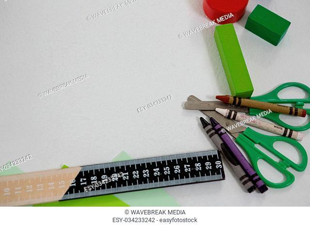 Various school supplies arranged on white background