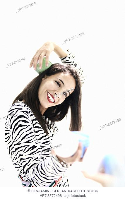 woman with cosmetic products