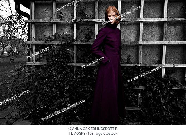 Teen female with red hair in purple coat