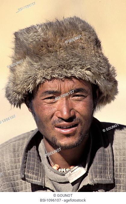 ASIAN MAN Winter trekking at the village Tingri near the southern frontier of Tibet and the norther frontier of Nepal at the monastery Rongbuk at the foot of...