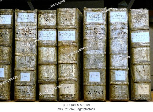 24.05.2015, Germany, Wittenberg, Several Luther books standing side by side in shelf . - Wittenberg, Germany, 24/05/2015