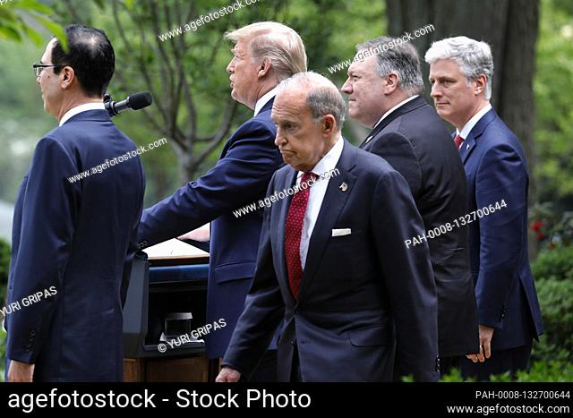Director of the National Economic Council Larry Kudlow walks behind United States President Donald J. Trump as he delivers remarks on China in the Rose Garden...