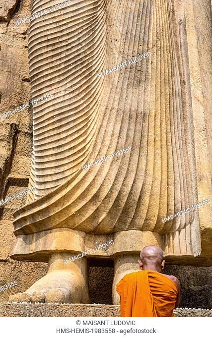 Sri Lanka, North Central province, Kekirawa, Avukana temple, Buddha statue (abhaya-mudr position) in the 5th century carved directly into the granite hill 12...