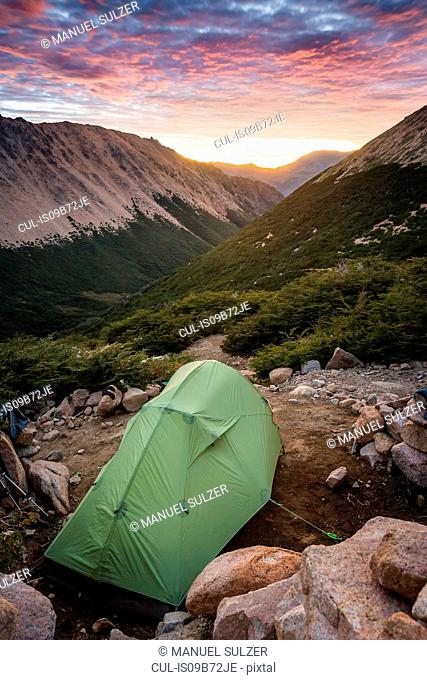 Tent at mountain landscape at sunrise, Nahuel Huapi National Park, Rio Negro, Argentina