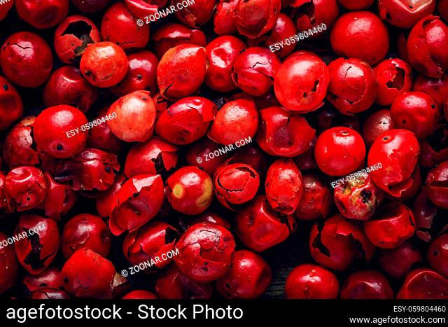 Pink pepper macro background texture. Top view