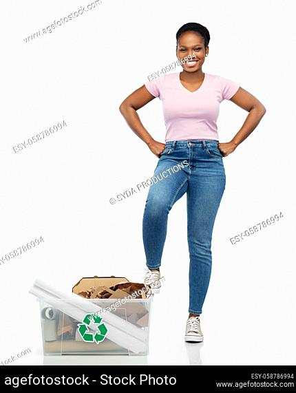 happy african american woman sorting paper waste