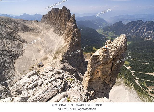 Panoramic view during climbing Stabeler Tower at Torri del Vajolet. Fassa Valley, Dolomites, Trentino, Italy