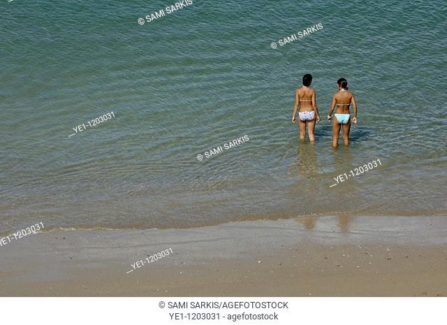 Two teenage girls bathing at the beach