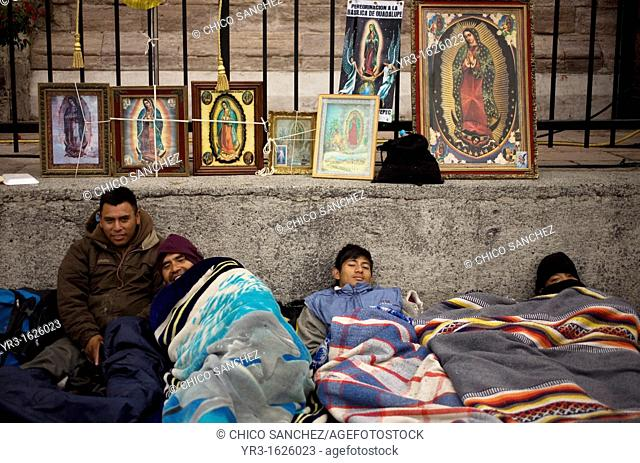 Pilgrims sleep by an image of the Our Lady of Guadalupe virgin in Mexico City, December 11, 2012  Hundreds of thousands of Mexican pilgrims converged on the Our...