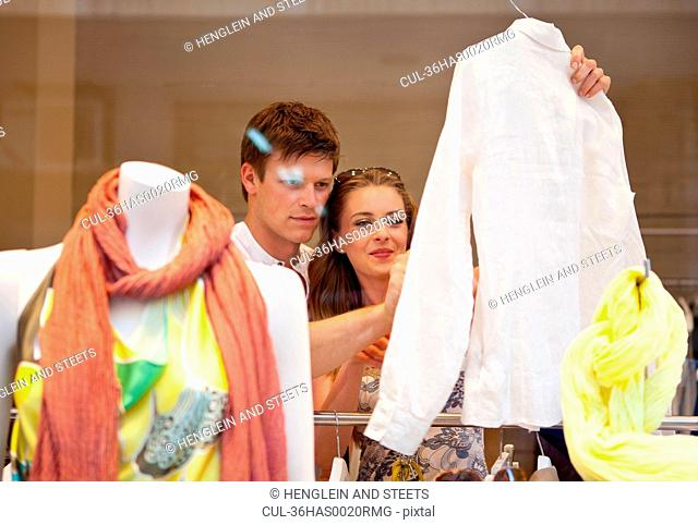 Smiling couple shopping together