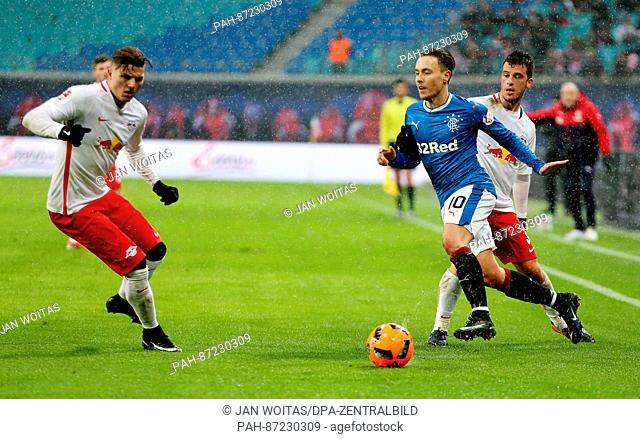 Glasgow's Barrie McKay (c) in action against Leipzig's Diego Demme (r) and Marcel Sabitzer during the soccer test match between RB Leipzig and Glasgow Rangers...