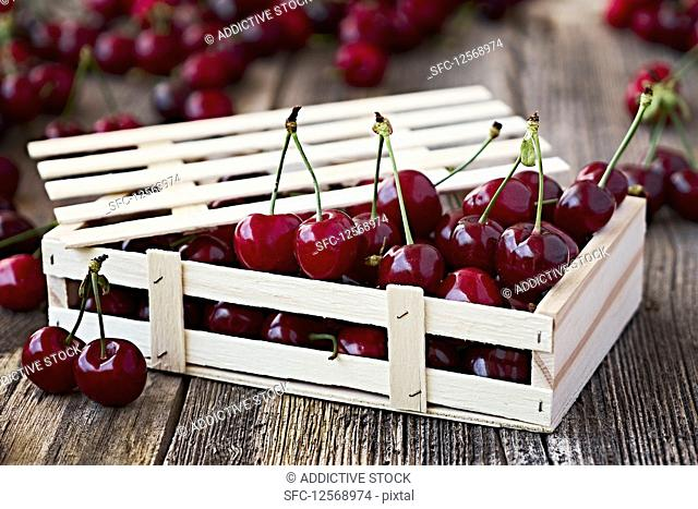 Wooden box with delicious ripe cherry