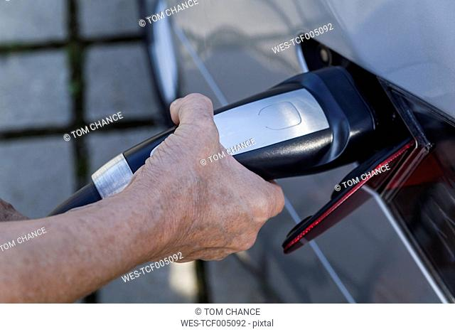 Charging of an electric car, close-up