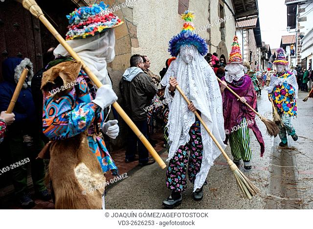 Participants in the Carnival of Lantz in Navarra broom through the streets giving people the assistant public