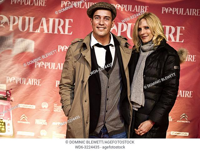Audience members pose on the red carpet at the Kino International during French Film Week in Berlin, Germany