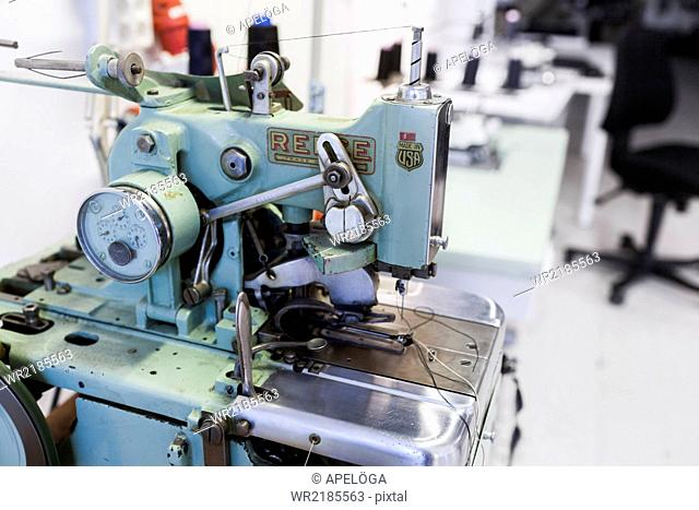 Sewing machine in jeans factory