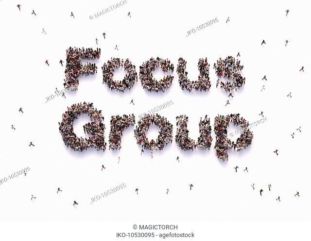 Overhead view of people forming words focus group