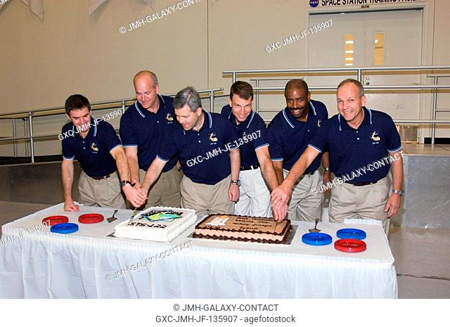 The STS-122 crewmembers celebrate the end of formal crew training with a cake-cutting ceremony in the Jake Garn Simulation and Training Facility at Johnson...